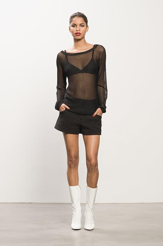 Fishnet Black Sweater, Cashmere Black Bra, Pique Black Shorts, Follow Me White Patent Mid-Calf Boot. Photo courtesy of Tamara Mellon