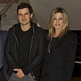 Jennifer Aniston put her arm around Orlando Bloom.