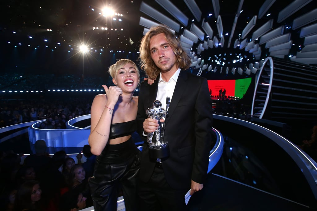 In 2014, Miley had My Friend's Place representative and former homeless man, Jesse Helt, accept her award.