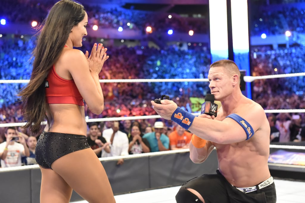"John Cena and Nikki Bella are engaged! John decided to pop the question at WrestleMania 33 following a tag-team wrestling match that he and Nikki won against The Miz and his wife, Maryse. Pretty perfect, huh? The over-the-top WWE pair has been going strong since 2012, and fans have gotten plenty of glimpses at how in love they are in episodes of Total Divas and Total Bellas, as well as a few fun red carpet events. Congratulations to the happy couple! A #WrestleMania moment for the ages! After winning their #MixedTag, @JohnCena PROPOSES to Nikki @BellaTwins at The #UltimateThrillRide! pic.twitter.com/lnjviTTL6c â€"" WWE (@WWE) April 3, 2017"