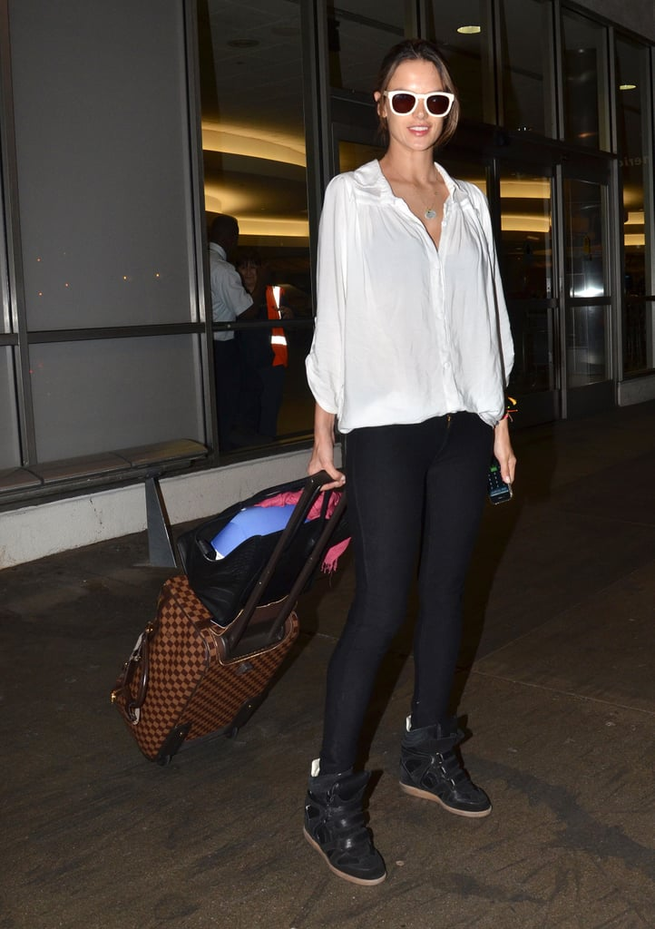 Alessandra Ambrosio may just have nailed the coolest travel gear we've seen — we're digging her pumped-up Isabel Marant kicks and white shades.