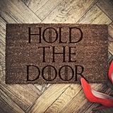 Hold the Door Doormat ($25)