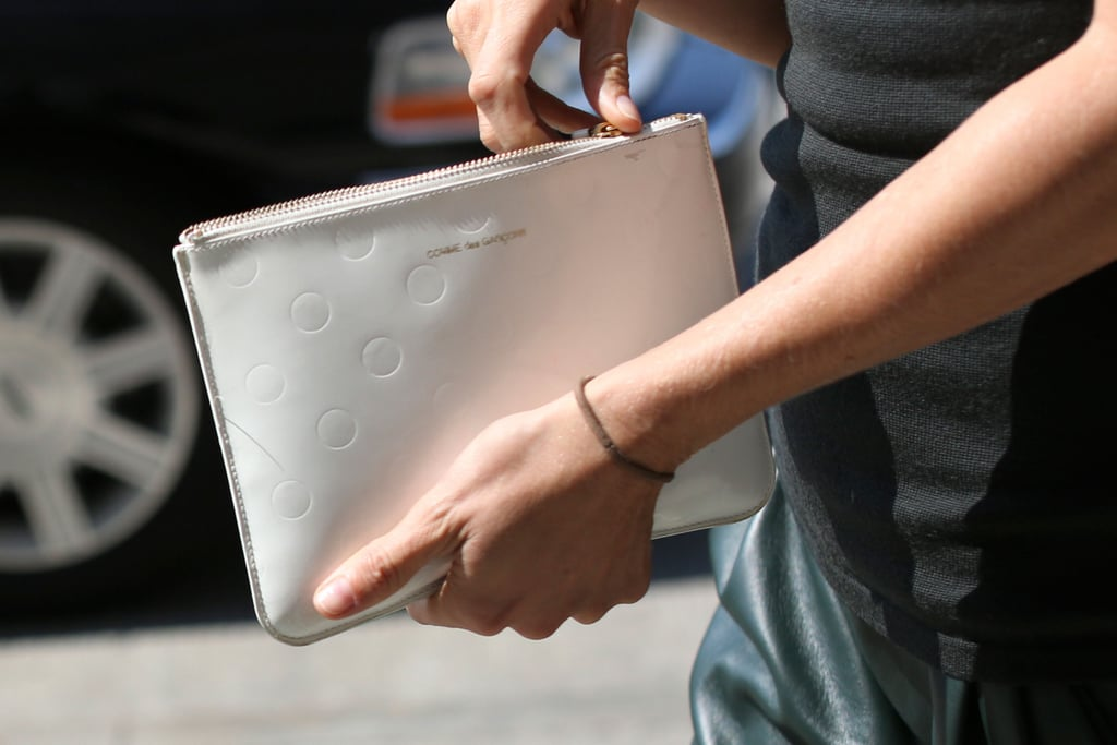 This zippered clutch would be a chic counterpart to, well, any look.