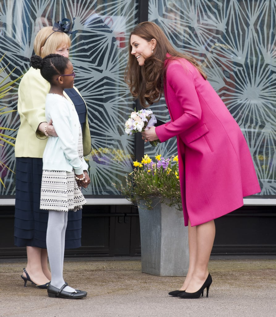 After this little girl presented Kate with a small bouquet of flowers, she bent down to talk to her. The cute interaction happened at the  Stephen Lawrence Centre in London in March 2015.