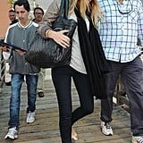 Blake Lively tried giving herself an incognito spin via her straw cloche hat and oversized quilted black bag.