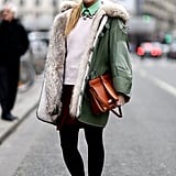 This showgoer bundled up her preppy look with the coziest kind of anorak.