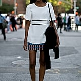 In her off-duty time, this model kept it just as chic in a boxy top and Zara skirt.