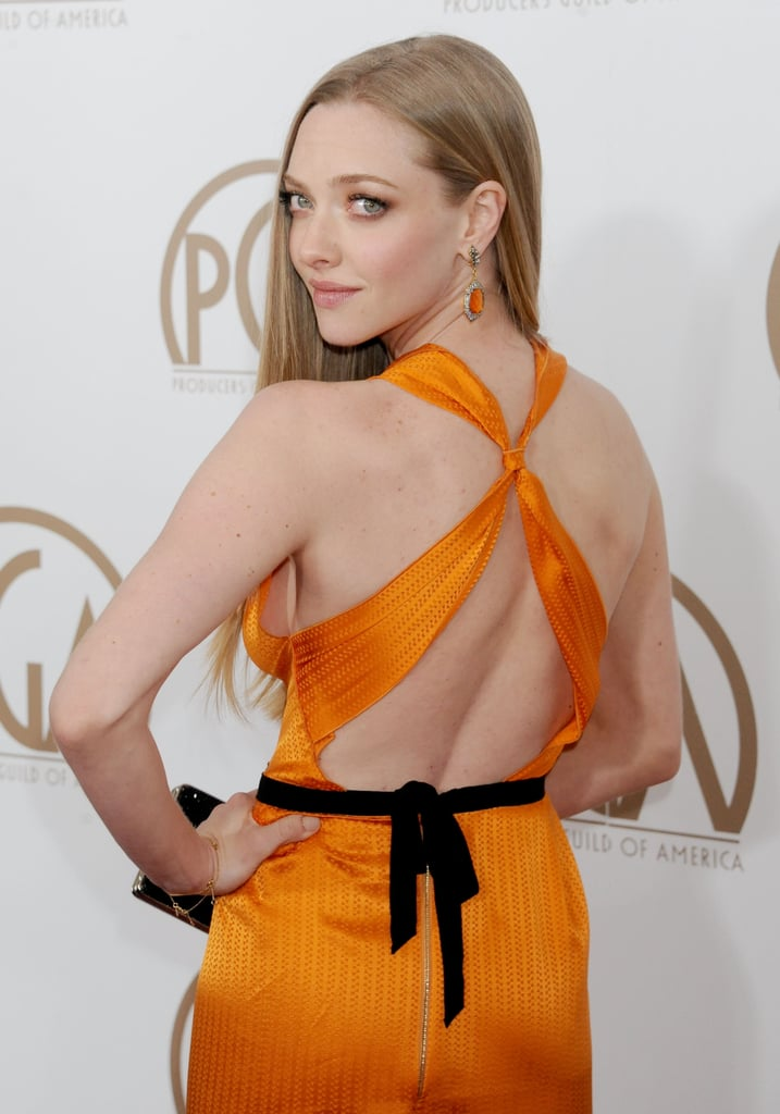 Amanda Seyfried attended the Producers Guild Awards in an orange frock.