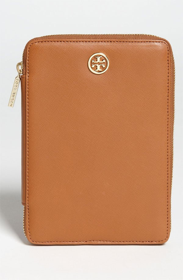 Load up your ereader with as many page-turners as possible, and then store it in Tory Burch's luxurious case ($165) until proper altitude is reached.