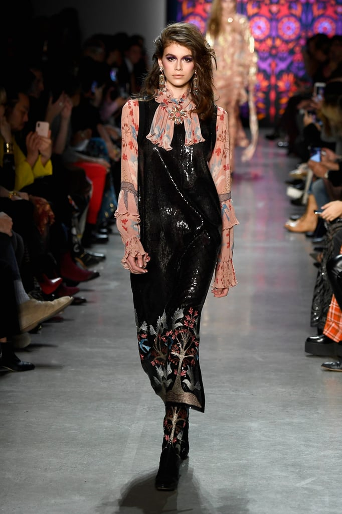 On the Catwalk, She First Wore a Black Sequined Dress Over a Pink Shirt