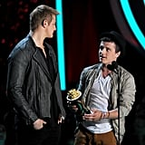 Hunger Games stars Alexander Ludwig and Josh Hutcherson accepted a golden popcorn statue.