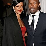 Rihanna threw a jacket over her shoulders and hung out with Jamie Foxx at GQ's afterparty.