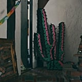 In the corner there's some art, including more paper chains, a dress form, and a multicolor cactus.