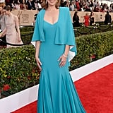 Molly Parker in a turquoise cape gown.