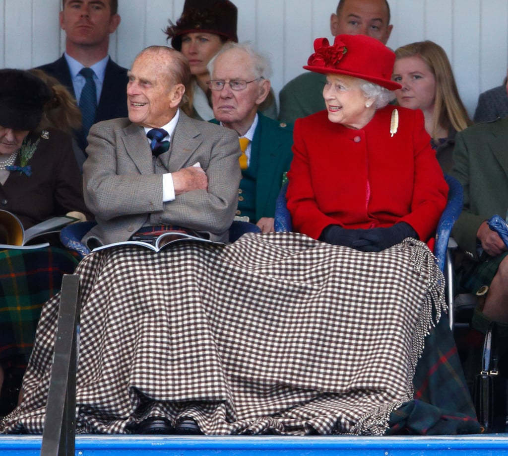 Prince Philip snuggled under a blanket with Queen Elizabeth II at the Braemar Gathering in September 2015.