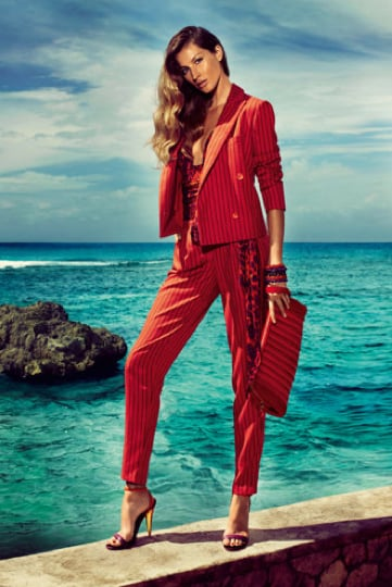 Gisele suits up in fiery reds for Salvatore Ferragamo. Source: Fashion Gone Rogue