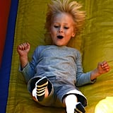 Sasha Schreiber took to the slide at the farmers market in Brentwood.