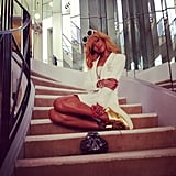 Rihanna posed on the infamous staircase at Coco Chanel's home in Paris — those gold kicks are everything. Source: Instagram user badgalriri