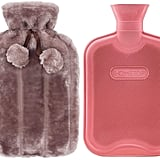 HomeTop Premium Classic Rubber Hot-Water Bottle and Luxurious Faux Fur Plush Fleece Cover With Pom Pom Decor in Nude Pink ($16)