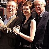 Anne Hathaway, Hans Zimmer, and Michael Caine stood by one another at Christopher Nolan's hand and footprint ceremony in LA.
