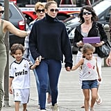 Jennifer Lopez held hands with her twins, Max and Emme Anthony.