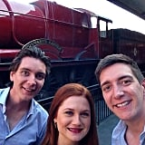 The Phelps twins and their onscreen sister, Bonnie Wright, reunited for a picture near the Hogwarts Express.