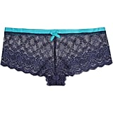 A sweet pair of briefs with a bold color contrast.  Elle Macpherson Intimates Cloud Swing lace Briefs ($32)