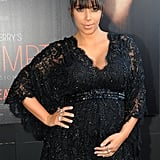 Kim Kardashian cradled her stomach at the Atlanta premiere of Tyler Perry's Temptation: Confession of a Marriage Counselor in March 2013.