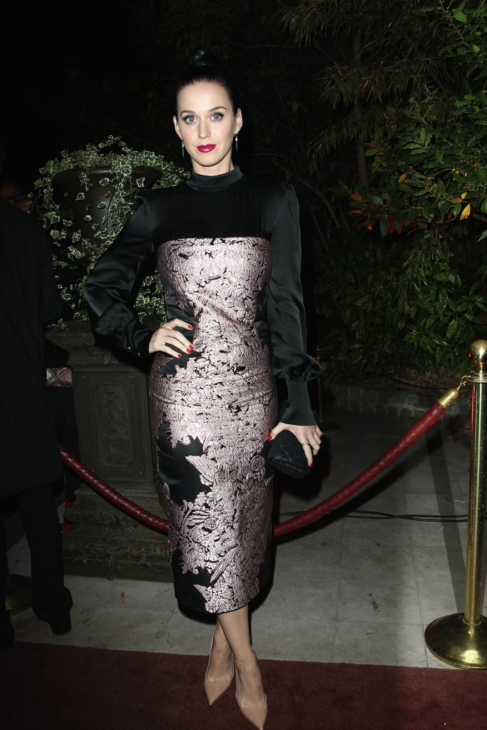 Perry attended the Mademoiselle C cocktail party in luxe brocade confection featuring silk bell sleeves and a modest mock collar.