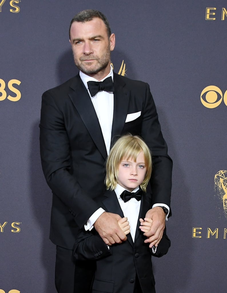 "Liev Schreiber is keeping up his trend of bringing the most adorable dates of all time to the Emmys. After walking the red carpet with his eldest son, Alexander Pete (whom he calls Sasha) at the 2016 Emmys, the Ray Donovan star brought along Sasha's younger sibling, Kai, for this year's event. Liev shared a few photos of him and his 8-year-old son preparing for their big night out on Instagram, captioning one cute snap, ""The very dapper and downright divine Kai Schreiber!!!"" Like Sasha, Kai clearly takes after mom Naomi Watts with his bright blonde hair. Still, the father/son duo managed to match with their dashing black tuxes. Since Liev is nominated for outstanding lead actor in a drama series, Kai just might be his good-luck charm!"