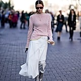Dress a simple long-sleeve striped tee with a mini skirt and heels.