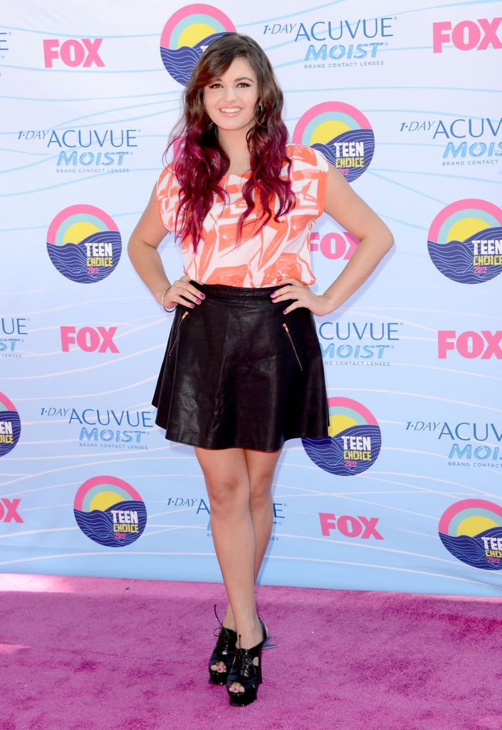 Rebecca Black paired a printed coral top with a black miniskirt.