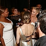Queen Latifah and Charlize Theron backstage at the 2013 Oscars.
