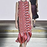 We can imagine Melania shopping the Mary Katrantzou runway for another statement-making Summer dress. A long warm-hued shift with embellishments and a fringed hem should be enough to get everyone talking.