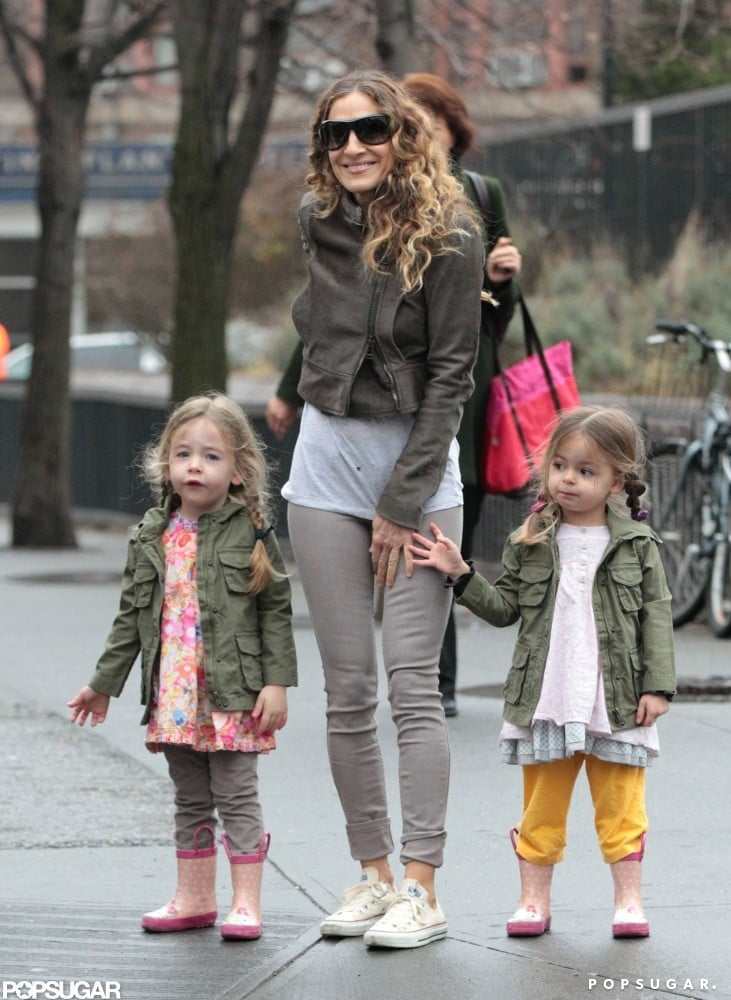 """Sarah Jessica Parker stepped out with her family in NYC yesterday morning. SJP walked with her twins, Loretta and Tabitha, who both wore matching pink wellies, while Matthew kept up with their eldest child, James, who was decked out in an animal hat. SJP had some exciting news this week as the Sex and the City prequel, The Carrie Diaries, premiered last night on The CW. The show officially marks SJP handing over the """"Carrie"""" baton to up-and-comer AnnaSophia Robb, who plays the young version of Sarah's famous character. Be sure to check out our chat with costume designer Eric Daman as we talked about what it was like to create young Carrie Bradshaw's closet."""