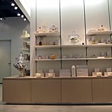 Fragrances are located near the back of the store.