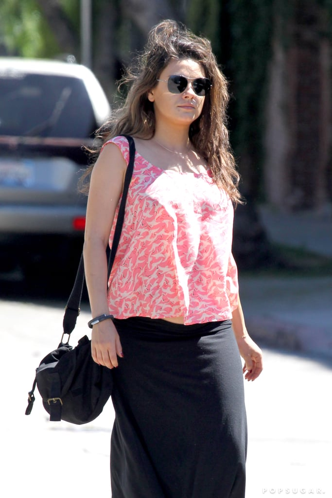 Mila Kunis Is on the Move With Her Growing Baby Bump