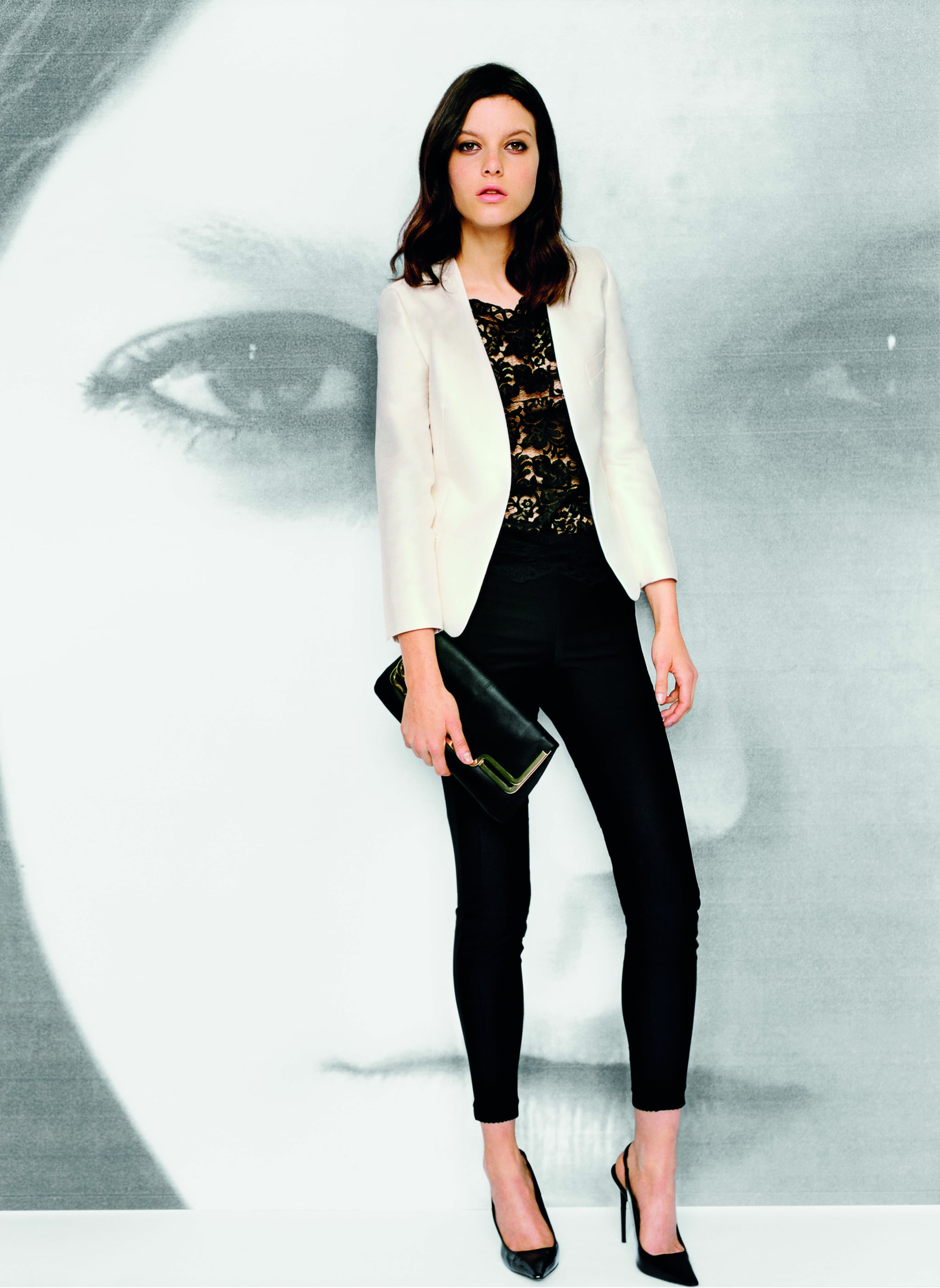 Collarless jacket in ivory, $199 Lace tee in black, $129 Tight lace insert trouser in black, $99 Frame clutch in black, $69