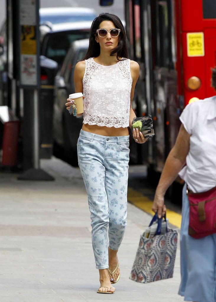 Wearing floral low-slung jeans with sandals and a crochet top.