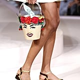 Kitschy, carnival-queen bucket bags with matching sandals.