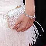 To go with her white confection, Diane donned a slick diamond bracelet and a crystal-encrusted clutch at the Killing Them Softly premiere.