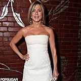 Jennifer Aniston wore a white dress to the Rock of Ages afterparty.