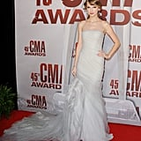 Fifty shades of whimsical glamour in a frothy strapless J. Mendel gown for the 2011 CMA Awards.