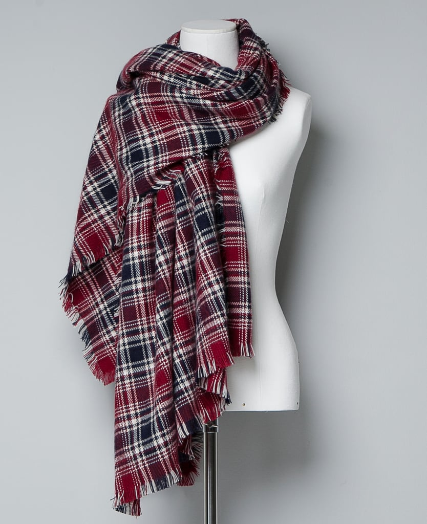 "Have a preppier friend in your life? This Zara checked scarf ($50) is classic, but the frayed hem has a bit of an edge to it. A great example of the ""best of both worlds,"" in our opinion."