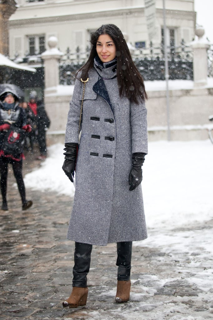 Caroline Issa balanced cozy, classic outerwear and slick leather leggings. Source: Adam Katz Sinding