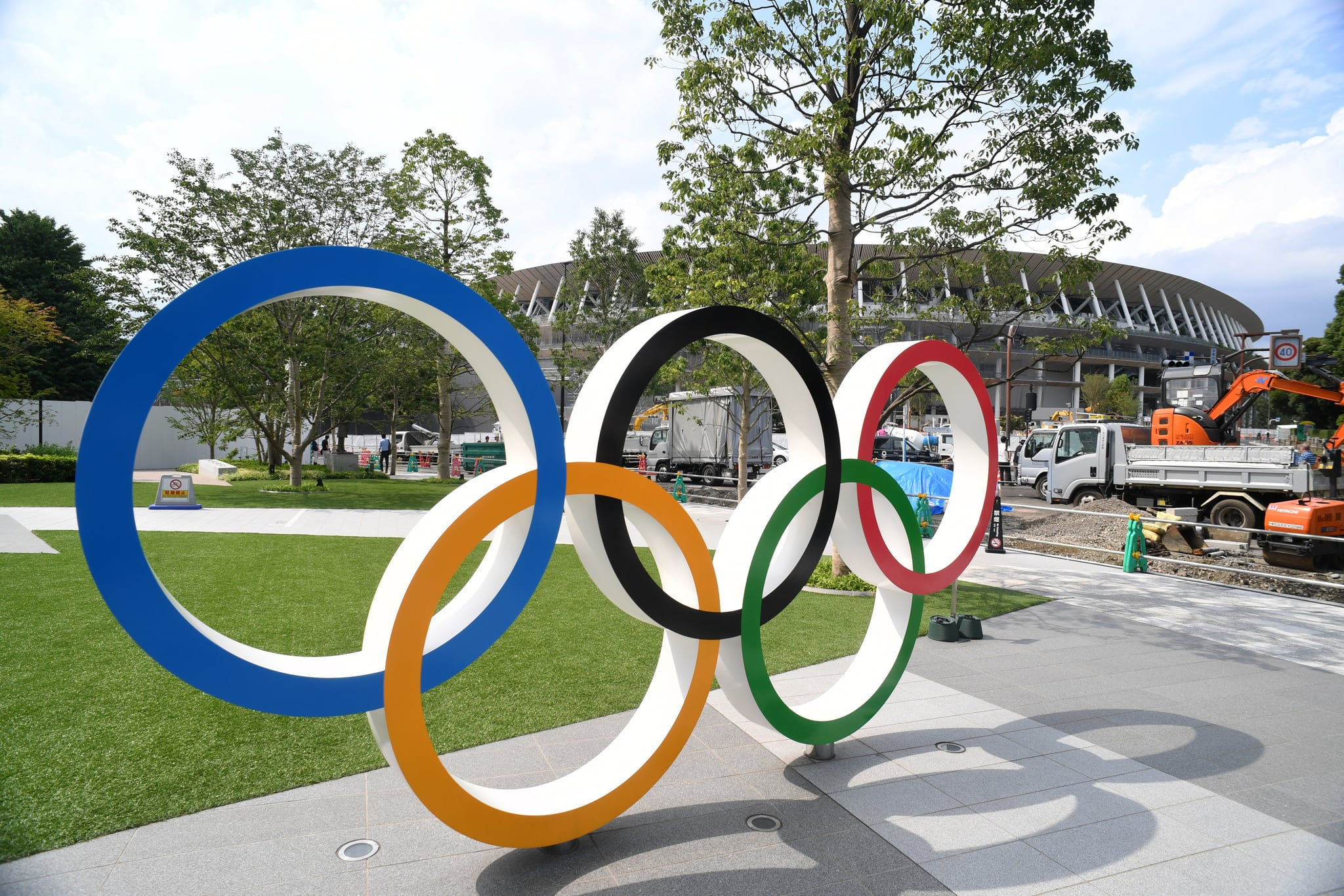 TOKYO, JAPAN - JULY 24: The Olympic Rings are displayed in front of the new national stadiumm which construction continues on the day marking the one year to go to the Tokyo 2020 Olympic Games on July 24, 2019 in Tokyo, Japan. (Photo by Etsuo Hara/Getty Images)