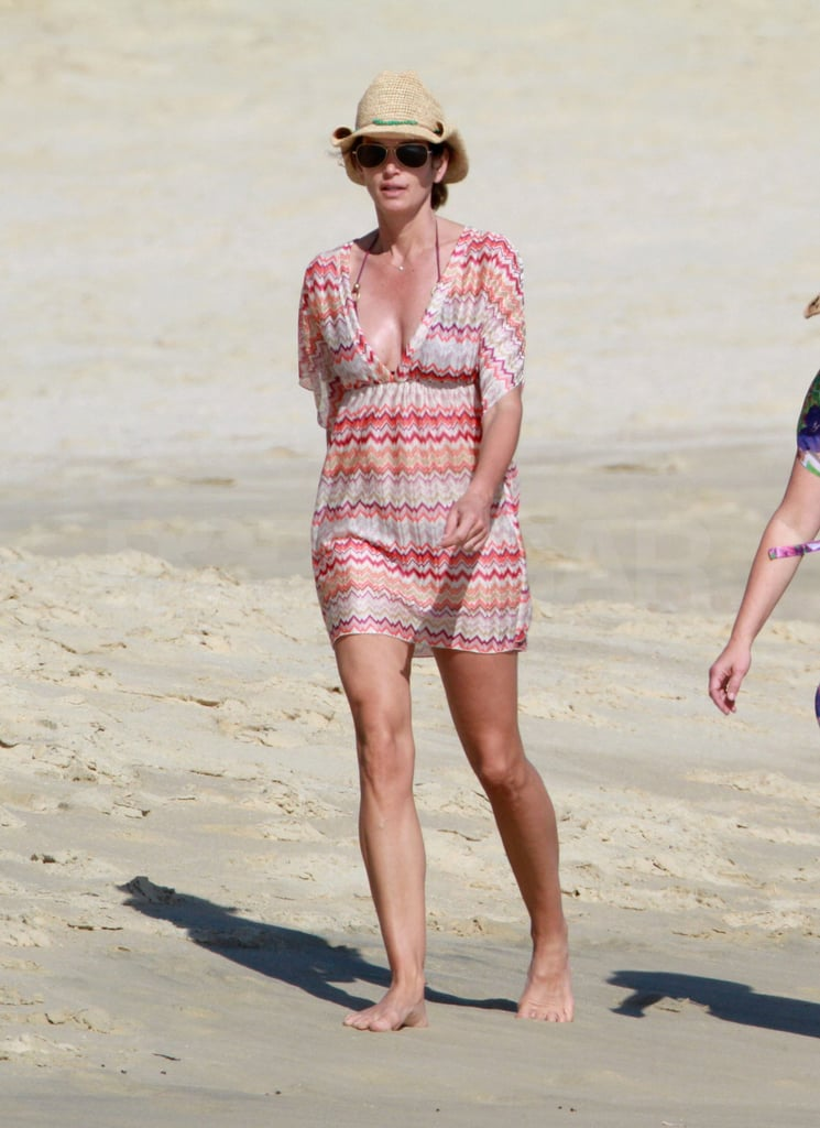 Cindy Crawford took a stroll with friends on the white beaches of Cabo yesterday. She's in Mexico with her husband, Rande Gerber, and their close friend George Clooney. Cindy, Rande, George, and George's girlfriend, Stacy Keibler, spent Thanksgiving south of the border, and it seems they're planning a similar celebration for the upcoming holidays. George is expected back in LA just after the new year for Hollywood's 2012 award season. He's up for multiple nominations, and it's likely his supportive friends Cindy and Rande will be there to cheer George on like they did over the Summer at the Venice Film Festival.