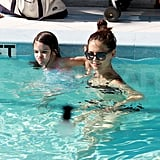 Katie Holmes swimming with Suri.
