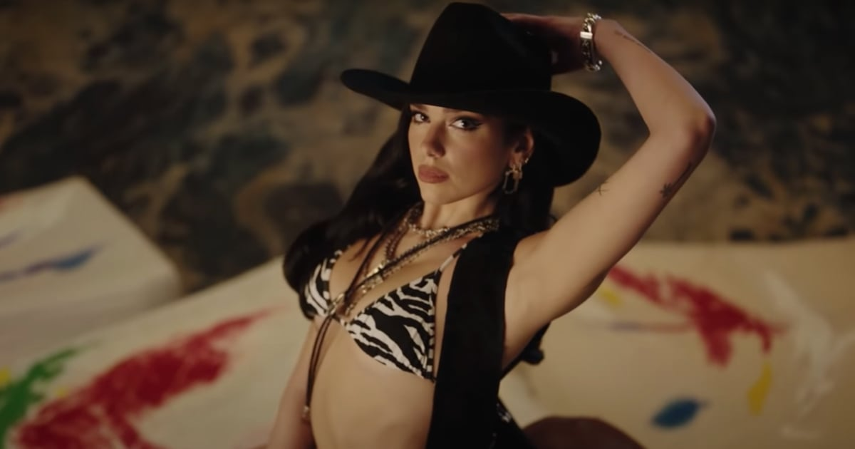 """Dua Lipa's Cowgirl Outfit Lights Up the Rodeo Arena in New """"Love Again"""" Music Video.jpg"""