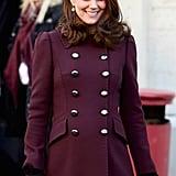 Wearing a Dolce & Gabbana coat.